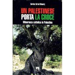 Un Palestinese porta la Croce