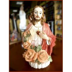 تمثال قلب يسوع مع شمعة